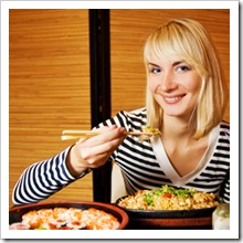 Beutiful blond girl in japanese restaurant