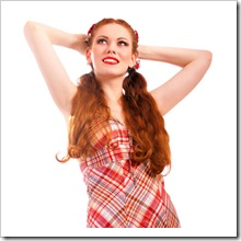 Portrait of laughing woman in checkered dress